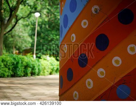 Colorful Dotted Side Frame Image At Blur Garden Background.