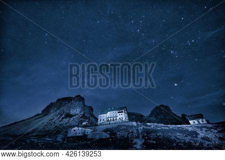 Night landscape over the Dolomites, Italy, Europe. On exposure shot