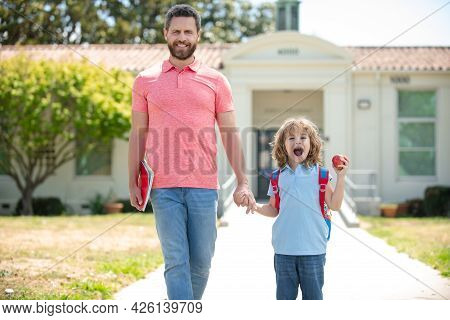 Father And Son Go To School, Education And Learning. School Boy Going To School With Father.