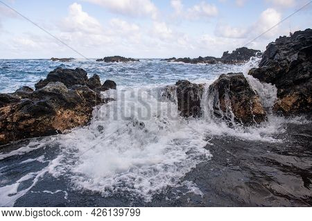 Sea With The Stones And Sand Of A Beach. Sea Waves Lash Line Impact Rock.