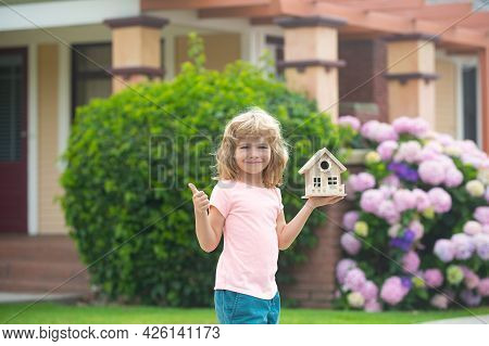 Child Making A New Dream Home. Housing A Young Family. Family Housing, Home Mortgage, Real Estate.