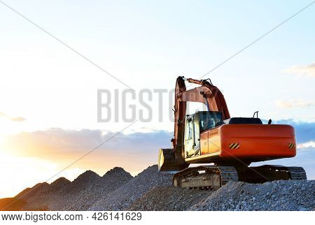 Excavator Loading Gravel. Mining In An Open Pit. Stone , Breakstone And Crushed Rubble For Road Cons