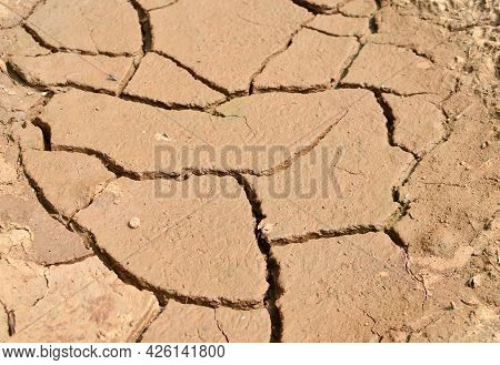 Dry Lake In The Process Of Drought And Lack Of Rain Or Moisture. Global Natural Disaster. The Cracke
