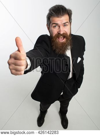 Business Man In Black Suit Smiling And Showing Thumbs Up, Isolated On White Background. Great Idea.