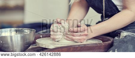Close Up Banner, Female Hands Make Dishes From Clay. Woman Hands Working On Potters Wheel. The Maste