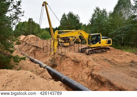 Natural Gas Pipeline Construction. Laying Oil Pipe In A Trench In The Ground. Petrochemical Industry
