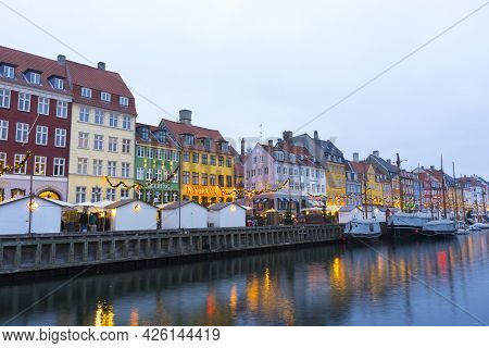 Copenhagen, Denmark - Nov 26, 2019 : Colourful Facades And Restaurants On Nyhavn Embankment With Old