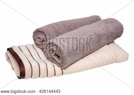 Towels Isolated. Closeup Of A Stack Or Pile Of Brown Beige Soft Terry Bath Towels Isolated On A Whit
