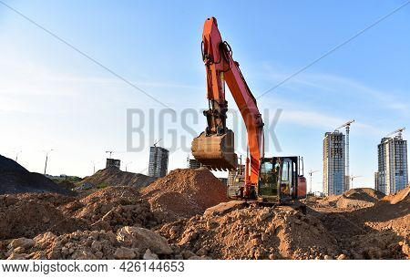 Bucket Wheel Excavator On Earthmoving At Construction Site. Backhoe Earthworks. Earthmoving Heavy Eq