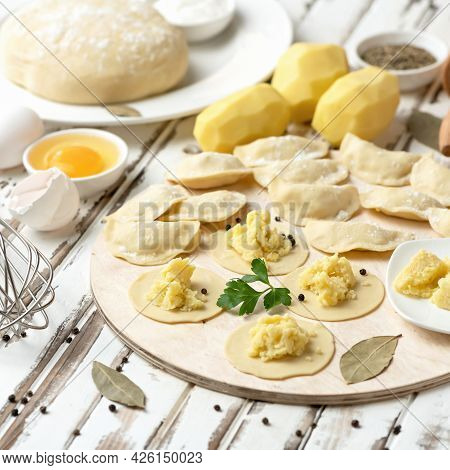Making Dumplings Stuffed With Mashed Potatoes. Convenience Food. Cooking Process. Slices Of Raw Doug