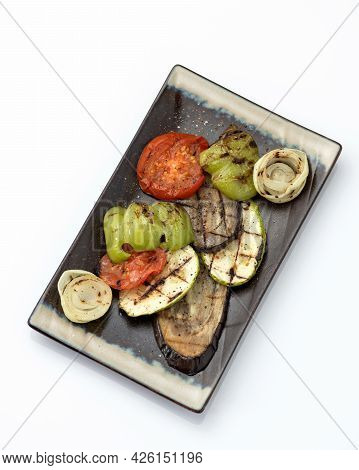 Grilled Vegetables On Platter. Clay Plate With Fried Zucchini, Eggplant, Bell Pepper, Tomato And Oni