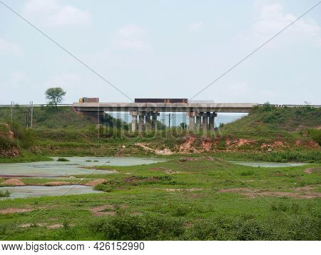 Wide Angle Natural River View With Transportation Bridge Architecture Blur Background.