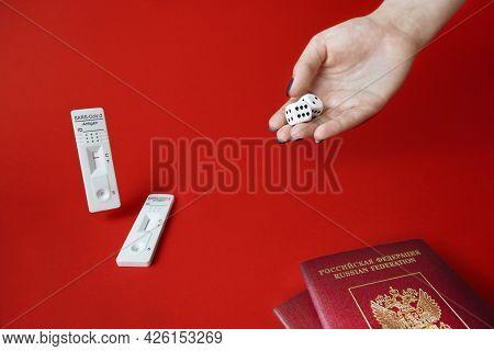 Rapid Sars-cov-2 Antigen Test, Negative Result, Unused, Hand With Dice On Red, Pair Of Tourist Passp