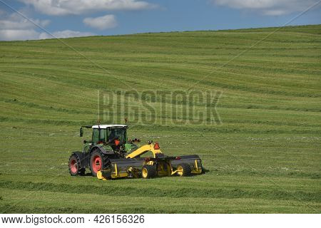 Countryside Landscape With Tractor On A Farm In Quebec, Canada