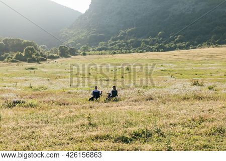 Male And Woman Admire The View Of The Mountains In The Journey