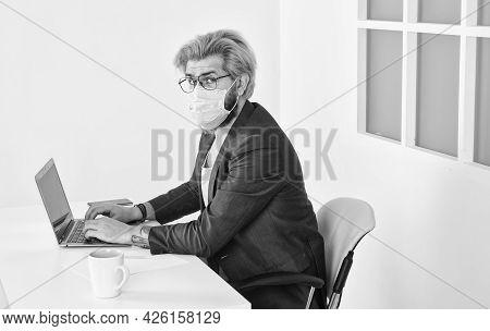 Limit Spread Of Disease. Remote Job. Man Freelancer Working Online. Guy Wear Mask While Surfing Inte