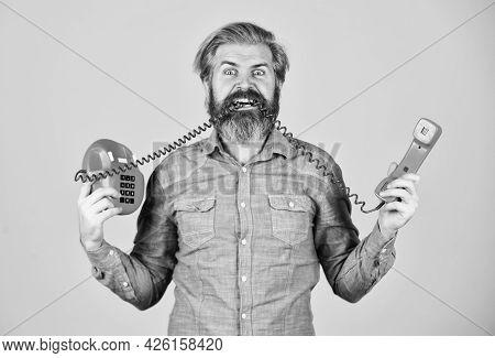 Creating Unique Ideas. Businessman Touts Retro Phone. Retro Customer Service. Communication. Man Tal