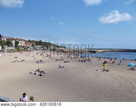 Luanco, Spain - August 7. View Of The Port And The Church Of The Small Town Of Luanco In Asturias, S