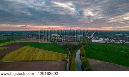 Aerial Landscape Of Countryside With Colorful Storm Clouds. Extreme Thunderstorm Over A Farm And Agr