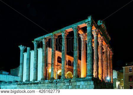 The Roman Temple Of Diana In Merida Illuminated At Night, Province Of Badajoz, Extremadura In Spain.