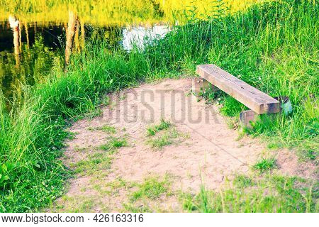 Old Wooden Bench On The River Bank
