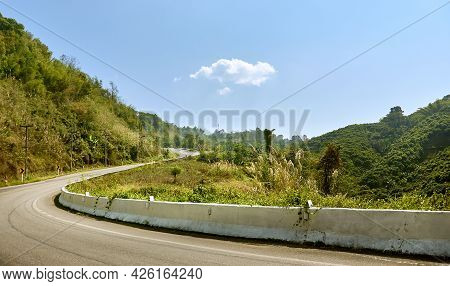 Mountain Road In Northern Thailand In Sunny Weather. The Road To The Tea Plantations At Doi Mae Salo