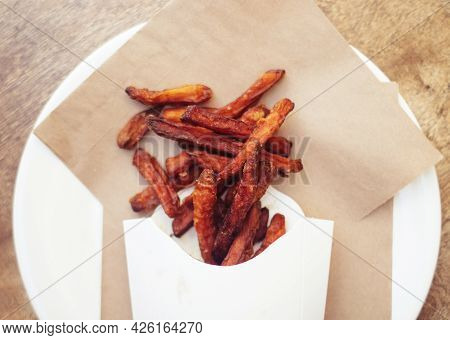 Сarrot Fries In A Cardboard Box. Vegetarian Fast Food Dish. Grilled Vegetables. Bbq Cooking Concept