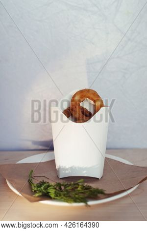 Close-up Of Onion Rings In Batter. Fried Vegetables At A Fast Food Restaurant. Vegetarian Cuisine In