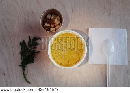 Close-up Of Mushroom Soup In A Paper Glass. Takeaway Food In The Restaurant. The Concept Of Vegetari