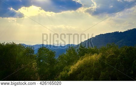 Sunset In The Mountains Of Northern Thailand. Mountains In The Haze. Rainforest In The Foreground. D