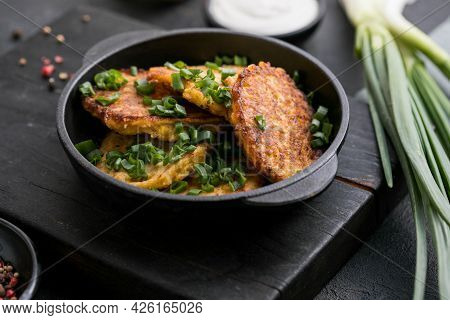 Delicious Onion  Fritters With Sour Cream And Green Onion On Plate, Closeup