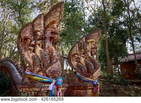 Statues Of Mythical Thai Dragons Guard The Stairs At Wat Phra That Chom Kitti. The Temple On A Hill