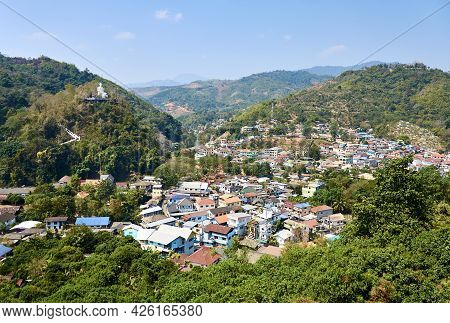 View from the hill of the Thai town of Mae Sai to the border town of Tachilek in Myanmar. view of th