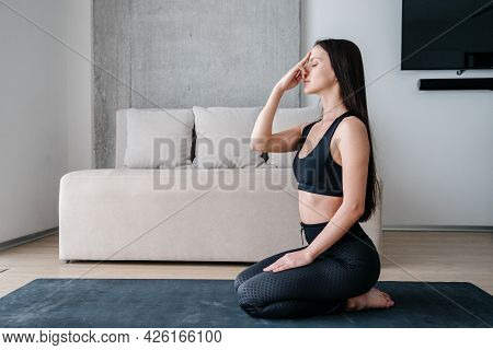 Side View Of Healthy Brunette Woman Touching Her Nose While Doing Alternate Nostril Breathing Exerci