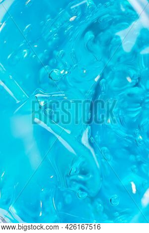 Cosmetic Liquid Gel Serum Lubricant Hyaluronic Acid Oxygen Bubbles On A Blue Background. Facial Body