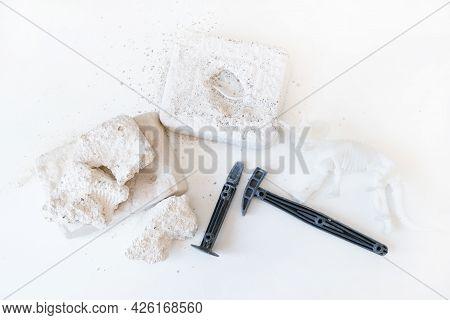 Dinosaur Excavation Game On A White Background. Dinosaur Skeleton, Bones, Hammer And Chisels.