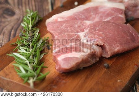 Close Up Of Raw Meat On Chopping Board On A Chopping Board