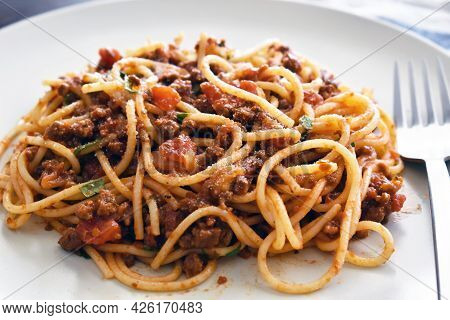 Spaghetti Bolognese With Minced Beef, Onion, Chopped Tomato, Garlic, Olive Oil, Stock Cube, Tomato P