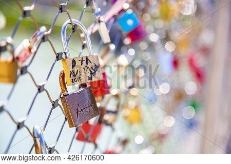 Salzburg, Austria - 9 April 2015 - Love Padlocks Hang On Chainlink Fence Of A Bridge In Salzburg, Au