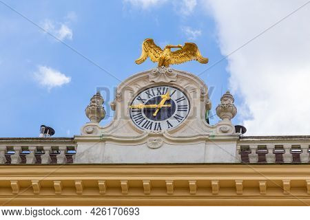 Vienna, Austria - 6 April 2015 - Close Up Of The Famous Schonbrunn Palace Clock Against Blue Sky On