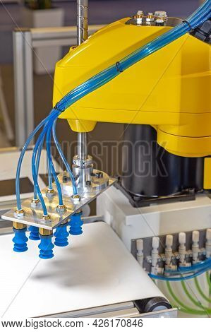 Automated Robotic Arm With Vacuum Suction At Conveyor Belt