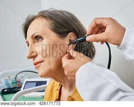 Portrait Mature Woman While Tympanometry And Test Of Middle-ear Function With Ent-doctor Using Tympa