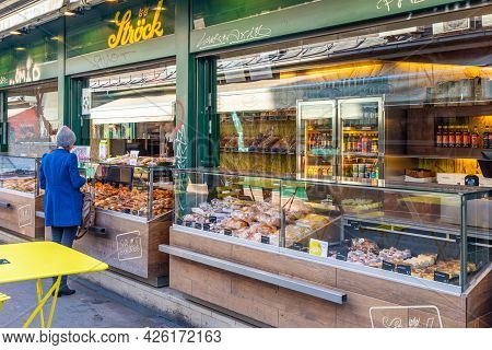 Vienna, Austria - 7 April 2015 - A Woman Stops To Buy Food At A Bakery Shop In Vienna, Austria On Ap