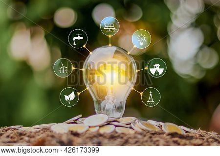 Energy Saving Lamp And Environmentally Friendly Energy Icon, Earth Day Concept, And Energy Saving