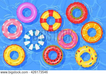 Inflatable Rings On Water. Top View Swimming Pool With Floating Rubber Kids Toys. Colorful Swim Ring