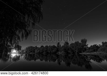 Night Shot Of A Tranquil River Mirroring The Trees And Stars In The Sky Showing The Southern Cross I