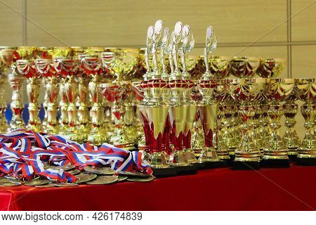 Cups And Medals For Awarding Winners In Competitions. Winner Concept.