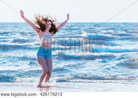 Jumping Happy Girl On The Beach, Fit Sporty Sexy Body, Woman Enjoys Sunset Freedom, Vacation, Summer