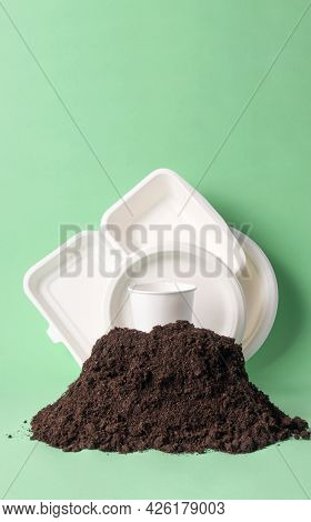 Set Single-use Tableware Popular Non-plastic Alternatives In Ground Heap, Vertical. Compostable Or B