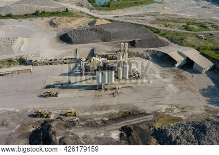 Arial View Of The Open Pit Mine Gravel Into Stone Crusher In Heavy Mining Machinery Equipment For Ea